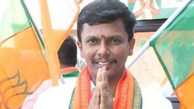 bjp youth wing leader jvr arun arrested with two and a half lakh rupees