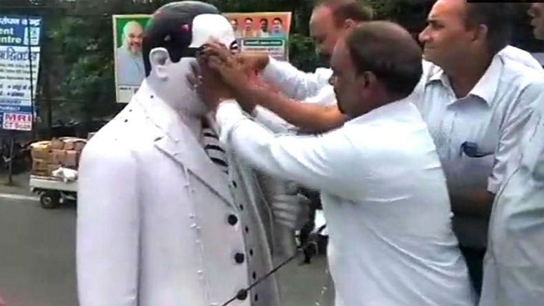 Dalit Lawyers Purify Dr Bhimrao Ambedkar Statue With Milk Gangajal after BJP leader garlanded it
